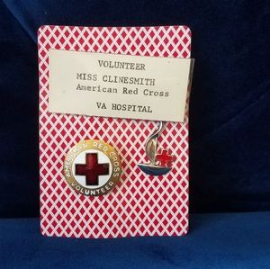 Vintage collectable WWII-era Red Cross pins.